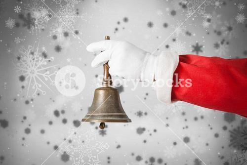 Composite image of cropped image of santa claus holding handle bell