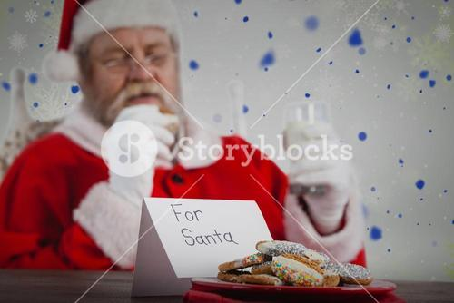 Composite image of close-up of cookies and santa clause