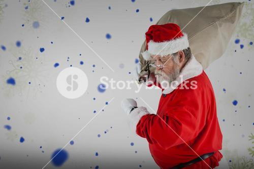 Composite image of santa claus looking at wristwatch while holding sack full of christmas gifts