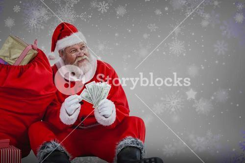 Composite image of santa claus sitting by sack full of gifts counting currency notes