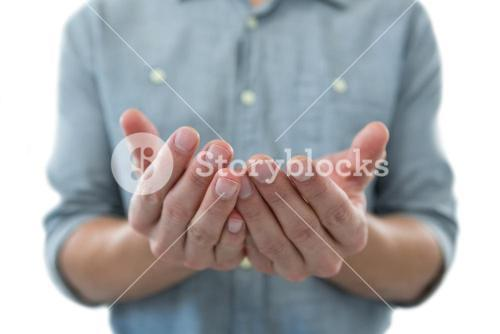 Cupped hands of man pretending to hold an invisible object