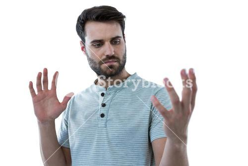 Man pretending to hold an invisible object