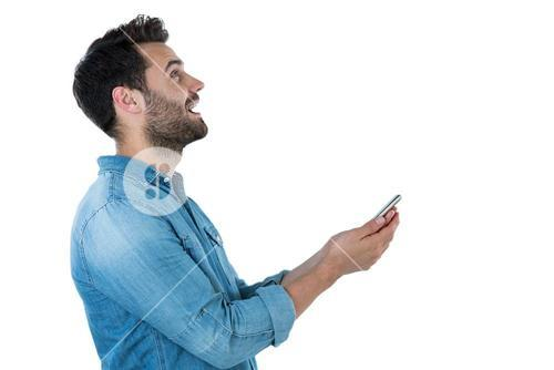 Man dreaming while holding a mobile phone