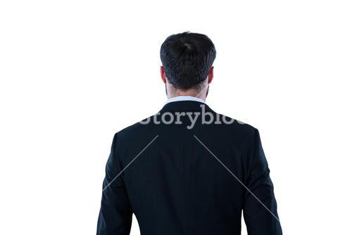 Businessman pretending to standing against invisible screen