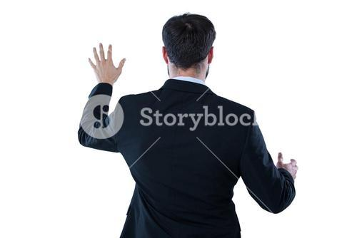 Businessman pretending to touch an invisible screen