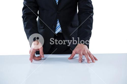 Businessman pretending to touch an invisible object