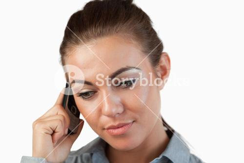 Close up of businesswoman listening closely to caller