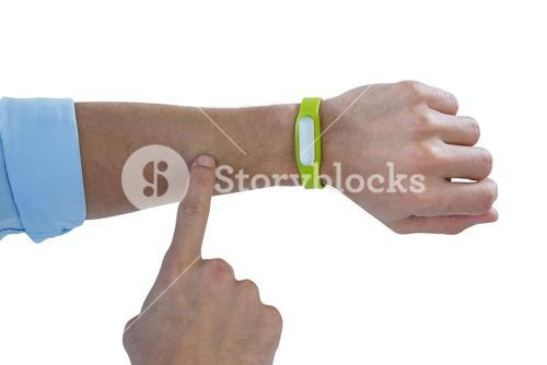Man hand using fitness band