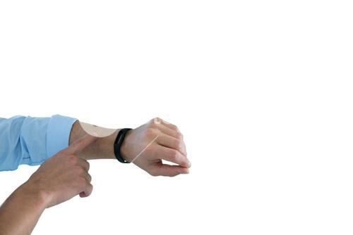 Man hand using a fitness band