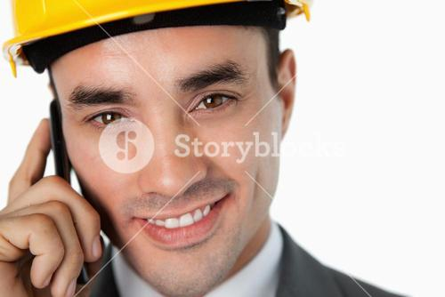 Close up of smiling architect speaking on the phone
