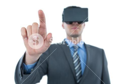 Businessman pointing his finger while using virtual reality headset