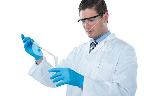 Doctor wearing medical gloves filling the test tube