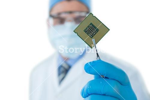 Doctor holding electronic chip with forceps