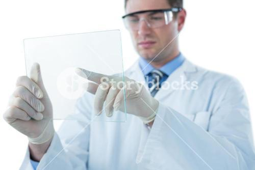 Male doctor using an futuristic digital tablet
