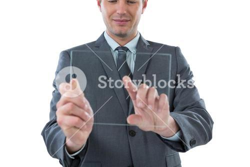 Businessman pretending to be using futuristic digital tablet