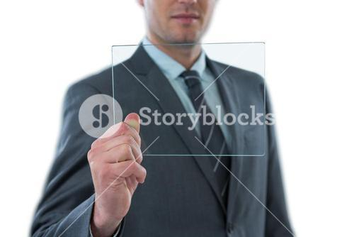 Businessman holding futuristic digital tablet