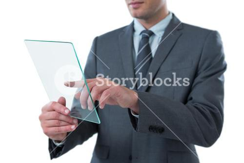 Businessman using futuristic digital tablet
