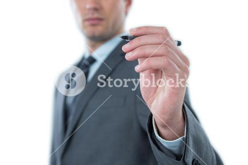 Businessman pretending to write with pen on an invisible screen