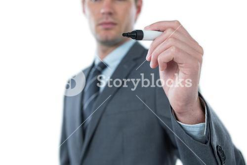 Businessman pretending to write with marker on an invisible screen