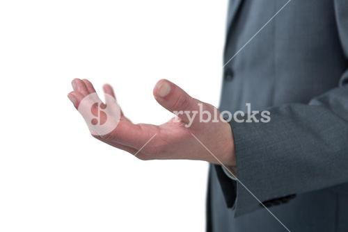 Mid section of businessman pretending to be holding