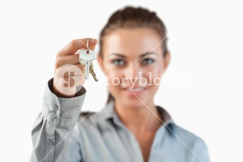 Close up of keys being held by female estate agent