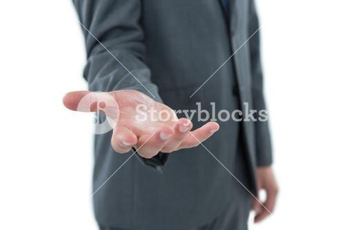Mid section of businessman pretending to hold an object