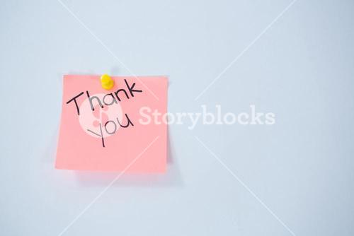 Text thank you written on adhesive note