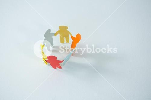 Circle of multicolored paper cut-out figures