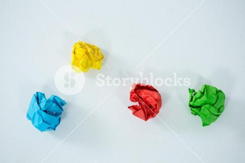 Multi-colored crumbled paper on white background