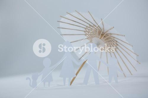 Family paper cut-out figures with cocktail umbrella