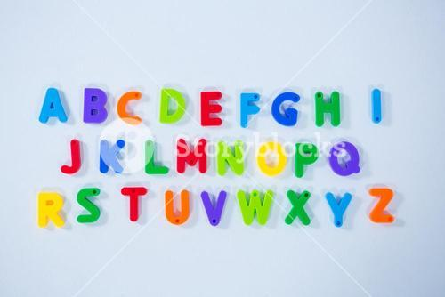 Multicolored alphabets on white background