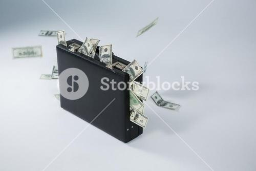 Bank notes coming out of briefcase