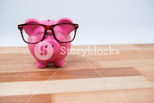 Close-up of piggy bank with spectacles