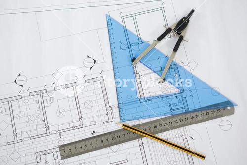 Blueprint with ruler, pencil and thumbscrew compasses