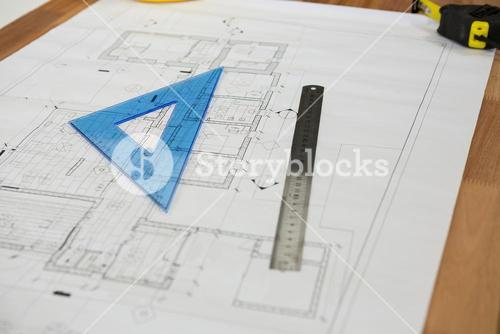 Blueprint with ruler on table