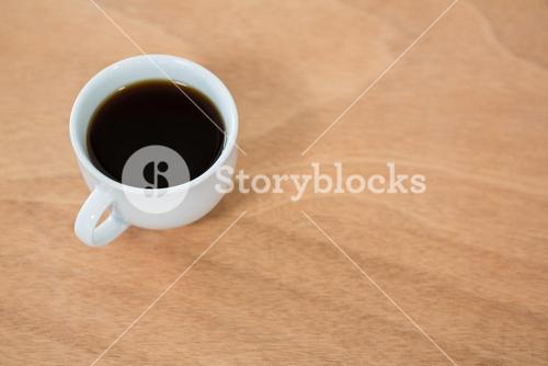 Black coffee on wooden table