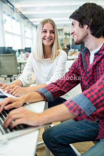 Graphic designers working over laptop
