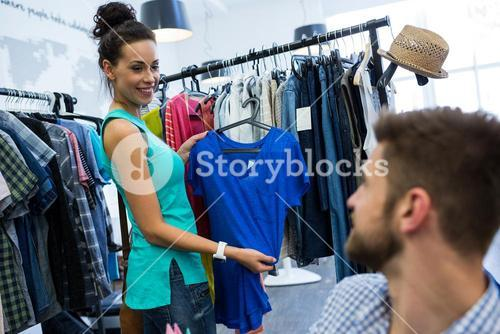 Woman showing clothes to man