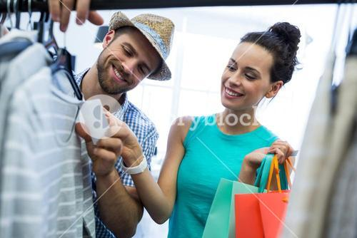 Couple doing shopping at clothes store