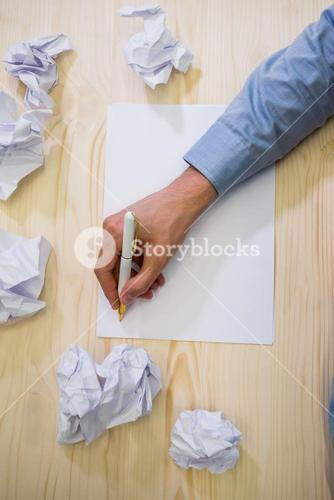 Graphic designer writing on paper
