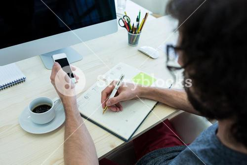 Business executive writing in diary