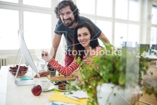 Graphic designers working over computer