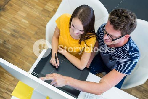 Graphic designers working at desk