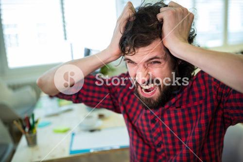 Frustrated business executive at desk