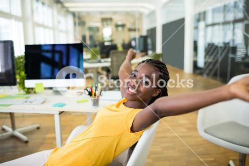 Female business executive with arms outstretched