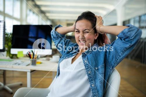 Frustrated female business executive at desk