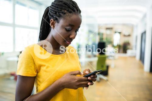 Woman text messaging on mobile phone