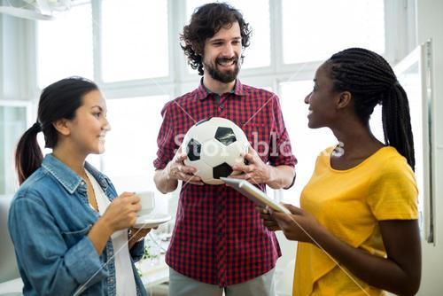 Team of business executives interacting with each other