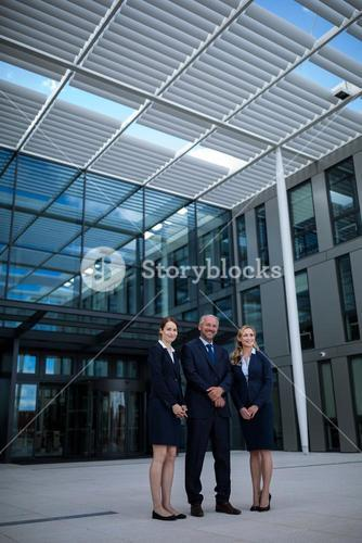 Confident businesspeople standing in the office premises
