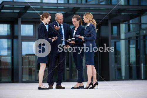 Businesspeople discussing in office premises